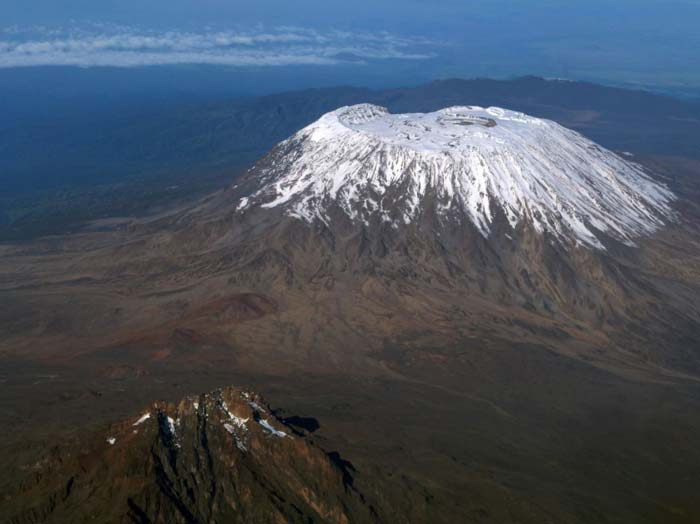 Aerial shot of mount Kilimanjaro's snow capped peaks by Staajabu Travel