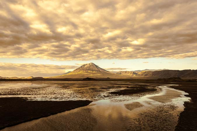 Beautiful view of lake Natron at dawn with mount Ol doinyo Lengai at the back by Staajabu Travel