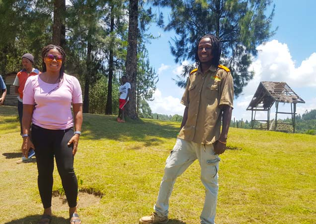 Staajabu Travel guide posing with a happy tourist at Themi Hill nature walk in Arusha