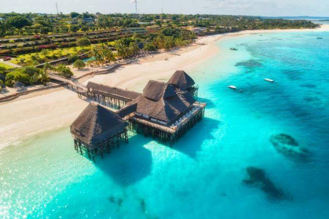 Aeriel view of beautiful hotel building on a white sand beach in Zanzibar by Staajabu Travel