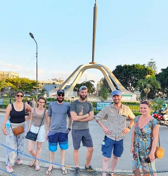 Tourists standing infront of Arusha declaration Mwenge monument in Arusha city