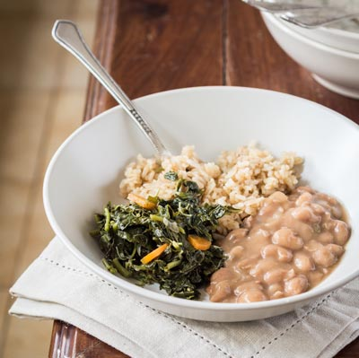 Rice, vegetable and beans on a white bowl-Arusha city food scene.