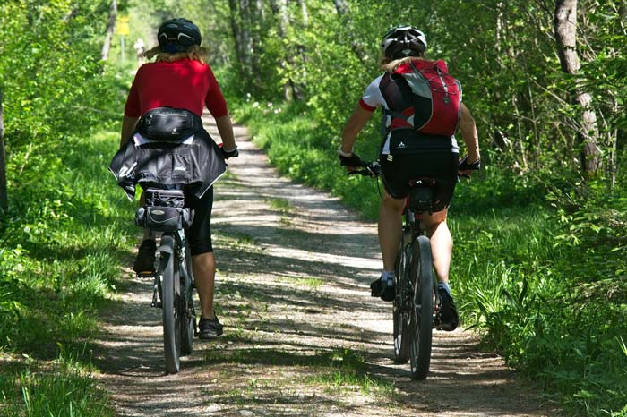 2 cyclists riding on a nature trail by Staajabu Travel Adventure safari